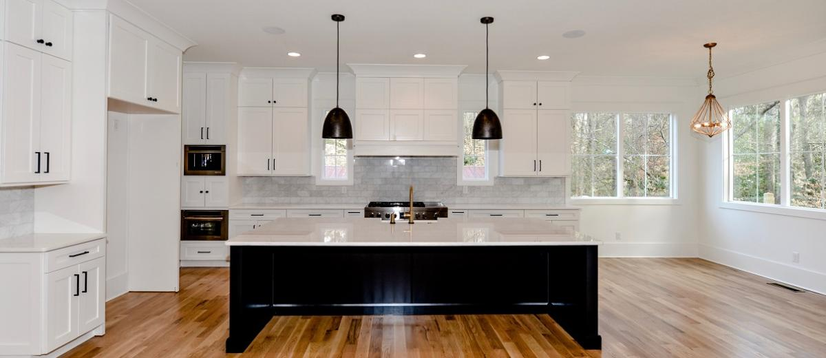 Marble Kitchen w Lots of Natural Light and White Oak Floors
