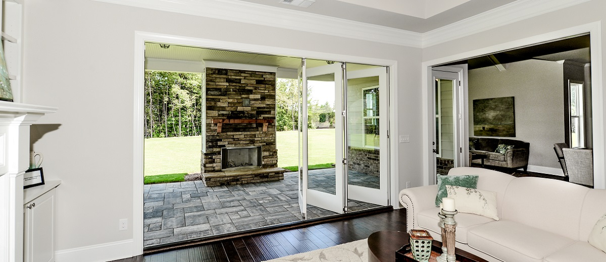 Bi-fold Doors Open to Bluestone Paver Patio at Regency Point