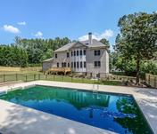 Home overlooks built-in pool in back yard of Custom East Cobb home built by Waterford Homes
