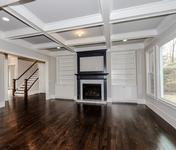 Open Living w Coffered Ceilings & Built-ins in this Brookhaven home built by Waterford Homes