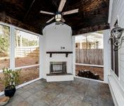White Painted Brick Outdoor Fireplace in Brookhaven home built by Waterford Homes