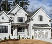 Farmhouse style Home with painted brick built by Atlanta Homebuilder Waterford Homes in Brookhaven