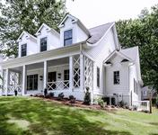 Modern Farmhouse style Home with large front porch by Waterford Homes in Chamblee, GA