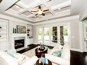 Family Room featuring Coffered Ceilings & Nana Wall bi-fold doors in the Callahan by Waterford Homes at Regency Point