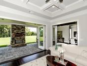 Nana Wall System bi-fold doors open to Stunning Outdoor Living at the Callahan by Waterford Homes at Regency Point