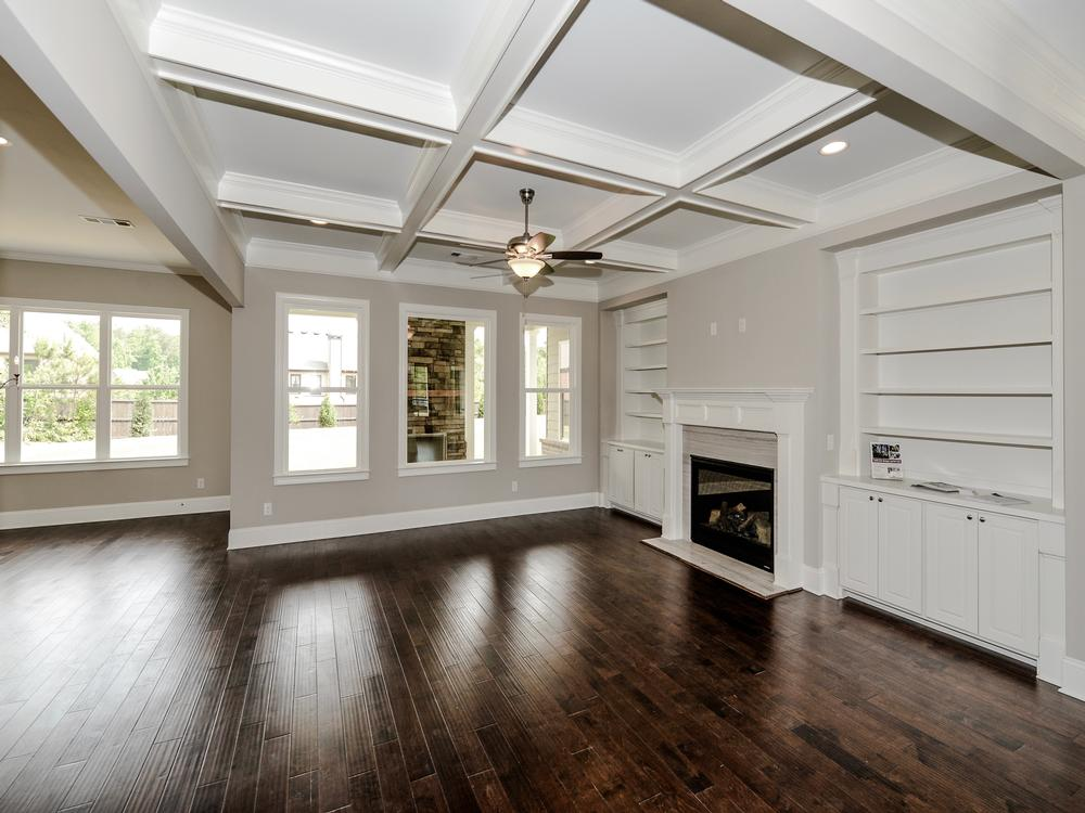 Open Floorplan Family Room With Coffered Ceilings And Built Ins At Provence By Waterford Homes