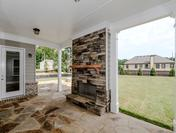 Cozy Outdoor Fireplace with Large Patio and Firepit at Provence by Waterford Homes at Regency Point