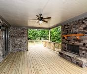 Outdoor Deck with Brick Fireplace in The Aragon built by Waterford Homes in Sandy Springs