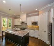 Kitchen Open to Family Room in The Williston built by Waterford Homes in Sandy Springs