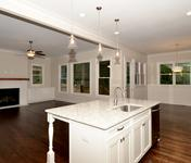 Open kitchen in this Oakhurst plan built by Atlanta Home Builder Waterford Homes