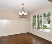 High Wainscoating in Formal Dining Room of home built by Atlanta Home builder Waterford Homes
