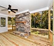 Colorful Outdoor FP  in home built by Atlanta Home Builder Waterford Homes
