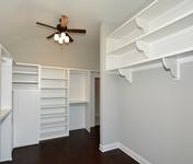 Master Closet Built Ins in Home built by Waterford Homes