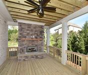 Covered Porch w Fireplace in home built by Atlanta Home Builder Waterford Homes