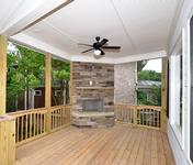 Covered Porch w Outdoor FP  in home built by Atlanta Home Builder Waterford Homes
